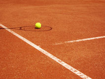 Tennis court and racket shadow with ball. Tennis court and racket shadow with yellow tennis ball Royalty Free Stock Image