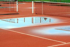 Tennis court after rain Royalty Free Stock Photo