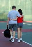 Tennis court romance. Couple on tennis court Royalty Free Stock Photo