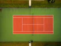 Tennis court seen from the air. Outdoors tennis court seen from the air directly above Stock Photos