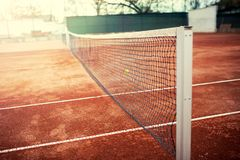 Tennis court on a sunny summer day. Close-up of Tennis court and tennis net on a sunny summer day Stock Image