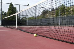 Tennis court with tennis ball by net Stock Image