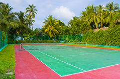 Tennis court on a tropical island royalty free stock images