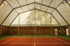 Tennis court. With a tree silhouette on a wall Stock Photos