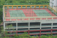 Tennis court on veranda of buildings. Stock Photography