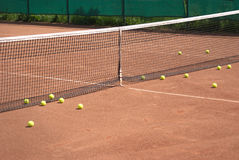 Tennis court and yellow ball before net Royalty Free Stock Photography