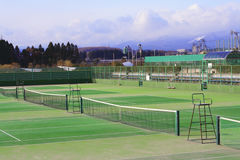 Tennis courts. General view of few tennis courts in a sports complex at the margin of a city Royalty Free Stock Photography