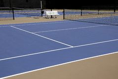 Tennis Courts. New Tennis Courts with benches and privacy netting Stock Photo