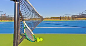 Tennis Courts. Modern tennis courts with tennis racket and balls stock photo