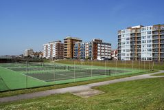 Tennis Courts on Hove seafront. UK. Tennis courts and apartment blocks on the seafront at Hove. Brighton. East Sussex. England Royalty Free Stock Images