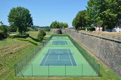 Tennis courts near the ancient wall Stock Photography