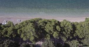 Tennis courts in Tucepi aerial view. Aerial view of the town Tucepi tennis courts by the beach, the Adriatic coast of Croatia stock video footage