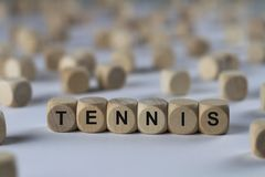 Tennis - cube with letters, sign with wooden cubes stock photo