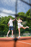 Tennis doubles team celebrating a win Royalty Free Stock Photos