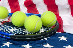 Tennis equipment on American flag Royalty Free Stock Photography