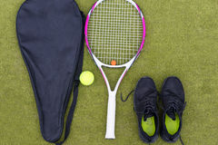 Tennis equipment set of tennis racket with cover, ball and male Royalty Free Stock Photo