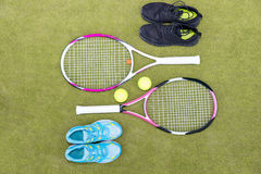 Tennis equipment set of two tennis rackets, two balls, male and Stock Photography
