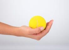 tennis för bollhandholding Arkivbild