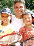 Tennis family. Royalty Free Stock Photo