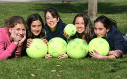 Tennis fan. Happy girls with big tennis balls Royalty Free Stock Photo