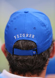 Tennis fan wears  Roger Federer hat during US Open 2014 semifinal match Royalty Free Stock Image
