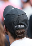 Tennis fan wears Roger Federer`s hat during US Open 2016 match at Billie Jean King National Tennis Center Stock Photography
