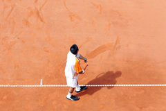 Tennis: First Serve. Tennis player on the ground line Stock Photography