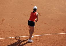 Tennis: First Serve. Female tennis player on the ground line stock images