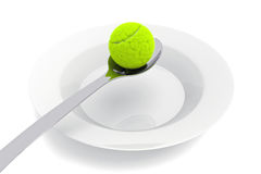 Tennis food - tennis ball and spoon on a white background Royalty Free Stock Images