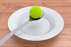 Tennis food - tennis ball and spoon on wood Royalty Free Stock Image