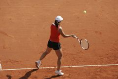 Tennis Forehand. Female tennisplayer plays forehand royalty free stock image