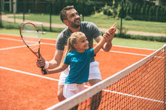 Tennis is fun when father is near. Stock Photos