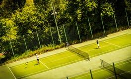 Tennis game. On green court. Poland Stock Photo