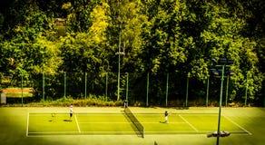 Tennis game. On green court. Poland Stock Photos