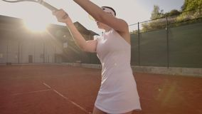 Tennis game on sunny day at tennis court young sportiv woman playing professional tennis. Tennis game on sunny day at stock video