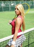 Tennis girl. Picture of lovely blond girl Royalty Free Stock Photography