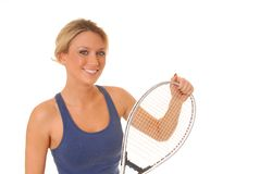 Tennis Girl. Lovely blond girl with a tennis racket royalty free stock photography