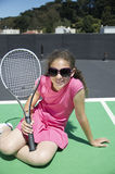 Tennis girl in sunshades Stock Images