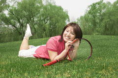 A tennis girl very happy on grass Stock Images
