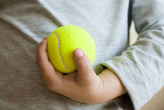 Tennis in hand Royalty Free Stock Images