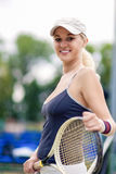 Tennis and Health Life Concept: Portrait of Positive Smiling Pro Stock Photos