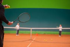 Tennis instructor Royalty Free Stock Image