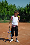 Tennis kid. Concentrated boy ready to play tennis Stock Photography