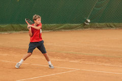 Tennis kid tournament. V TENNIS KIDS TOURNAMENT, UKRAINE, KIEV – MAY 18 : Unknown kid players from all over the Ukraine in action at a V Kids Tournament on May Royalty Free Stock Photos