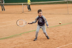 Tennis kid tournament. V TENNIS KIDS TOURNAMENT, UKRAINE, KIEV – MAY 18 : Unknown kid players from all over the Ukraine in action at a V Kids Tournament on May Stock Images