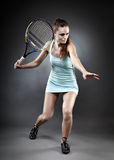 Tennis lady ready to hit the ball Stock Photo