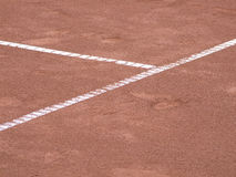Tennis lines on terrain with footsteps Stock Photography