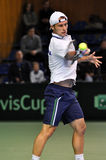 Tennis man Adrian Ungur in action at a Davis Cup match Royalty Free Stock Photo