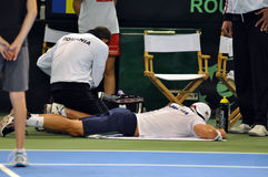 Tennis man Adrian Ungur suffered an accident. Romanian tennis man Adrian Ungur suffered an accident during a Davis Cup match. Romanian player Adrian Ungur wins Royalty Free Stock Photography