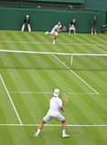 Tennis Match. Rodger Federer vs Richard Gasquet in Wimbledon Royalty Free Stock Photography